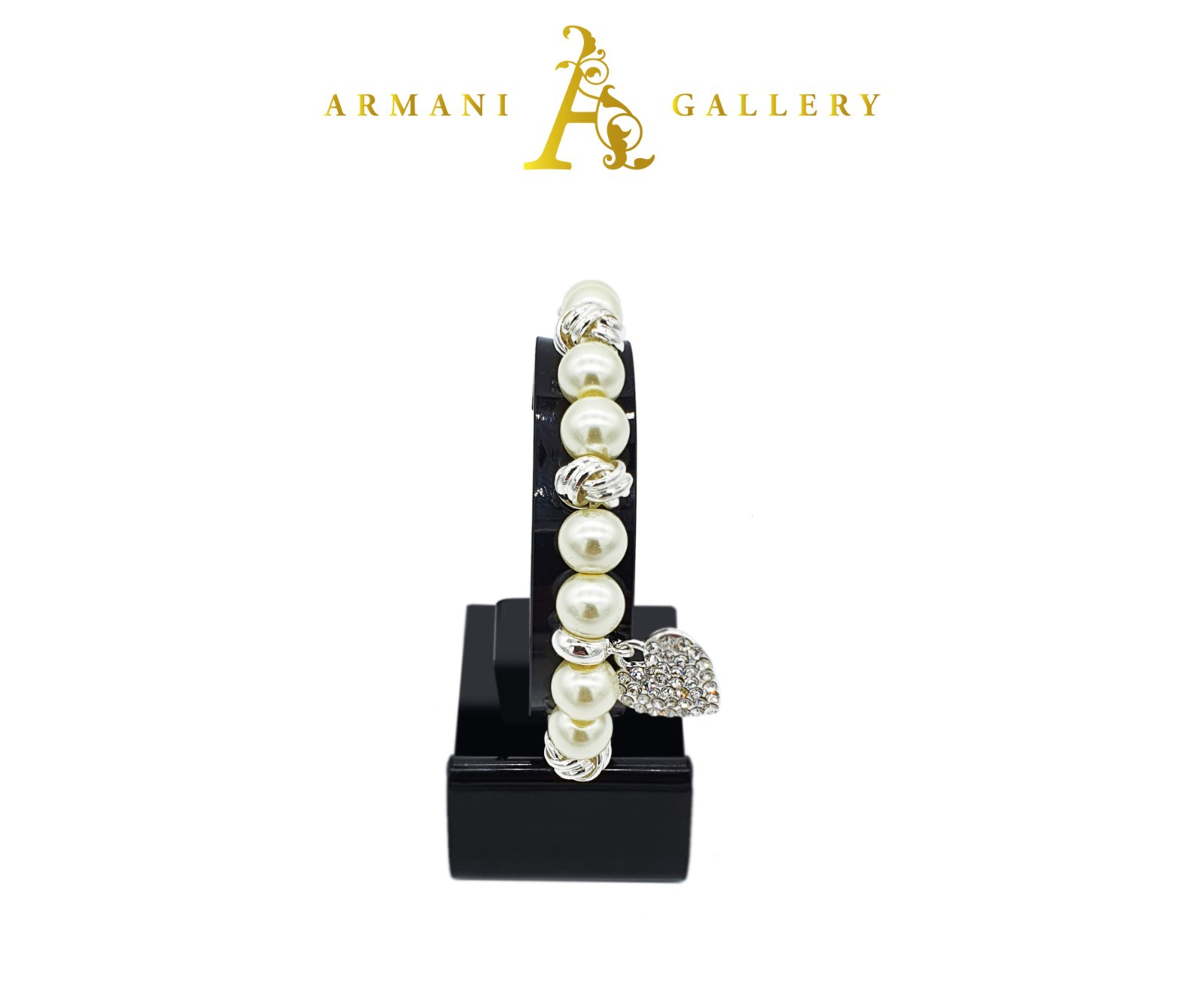Buy Diamonte & Pearl Bracelet with Heart